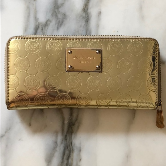 20ae967c8b37 ... uk michael kors metallic gold mk jet set zip wallet 7e3eb 6baf8